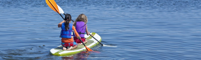 youth on stand up paddleboard