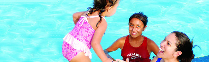 swim instructor with student