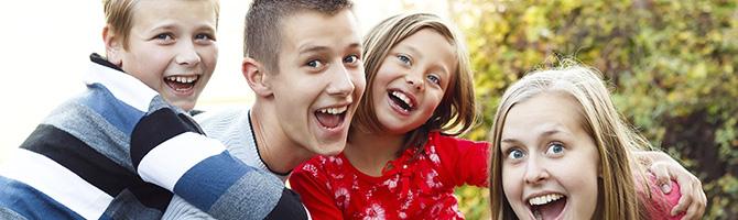 babysitter with happy kids