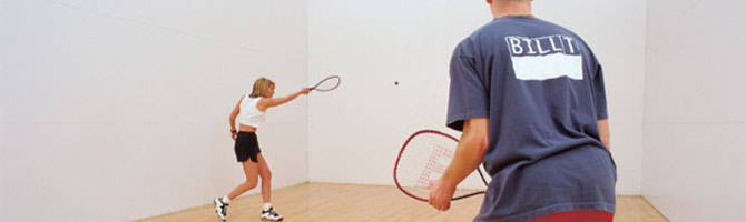adults playing racquetball