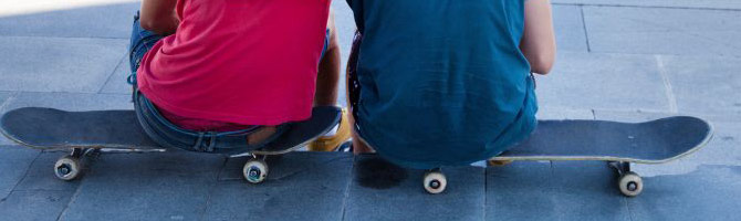 kids sitting on skateboards