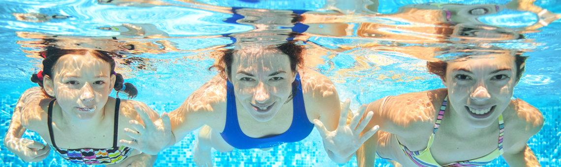 3 girls swimming in pool