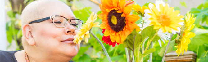 cancer patient smelling sunflower