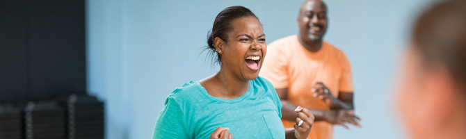 enthusiastic woman in group exercise class