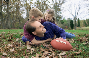 Family playing football.