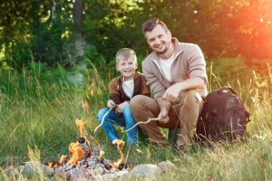Father and son by the fire