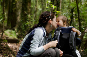 A mother and her baby backpacking