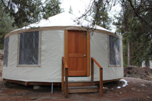 Yurts accommodate up to 12 people and are an easy walk to the shower house.